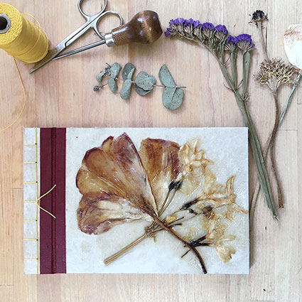 photo of stab binding with pressed flowers