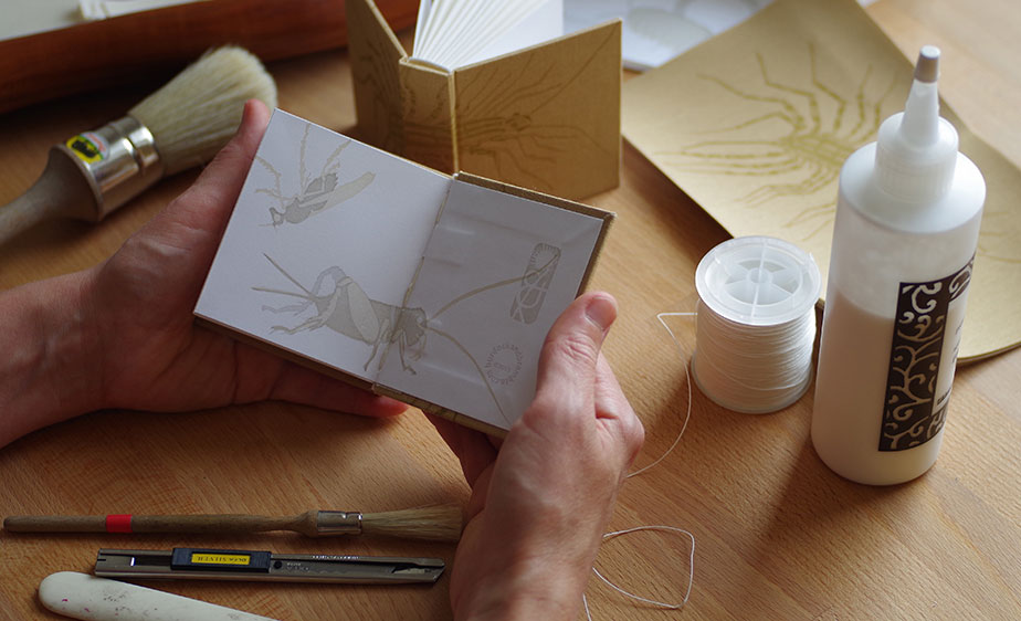 photo of bookbinding by hand